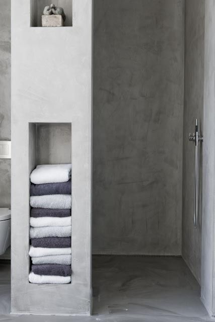 towel storage built in the wall next to the shower