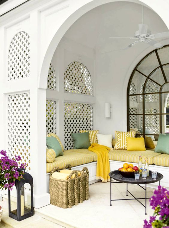 upholstered benches in a gazebo attached to the house wall