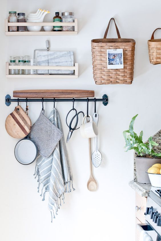 baskets on hooks and a metal rod