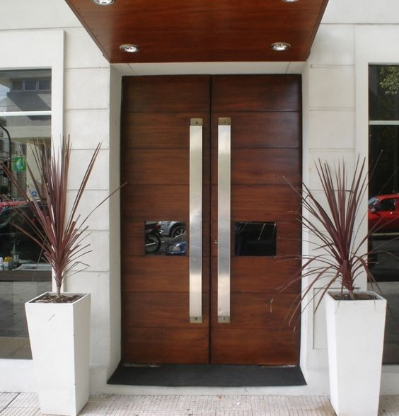 front wooden doors with glass panes and large handles