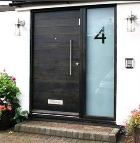 modern dark wooden door with an etched glass sidelight