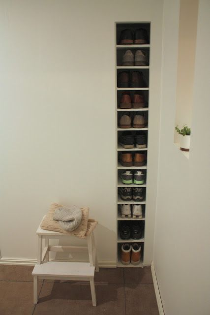 built-in shoes storage saves a lot of space and keeps the room uncluttered