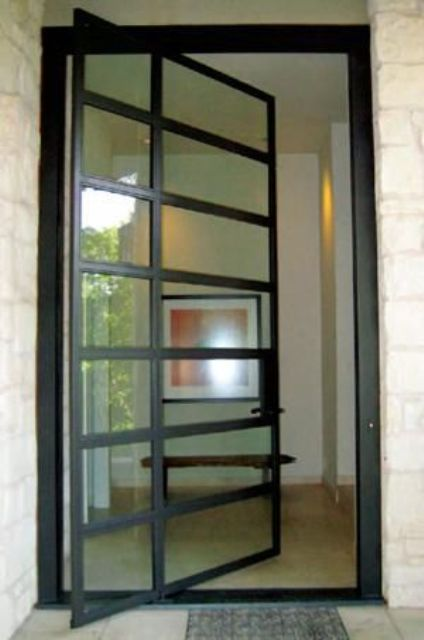 glass and steel pivot front door