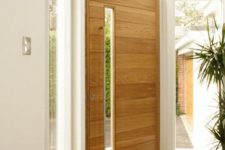15 light-colored wood door with a vertical glass pane
