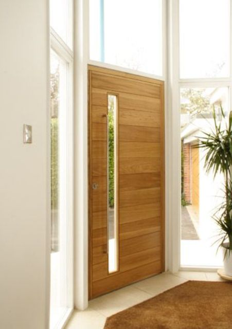 light-colored wood door with a vertical glass pane