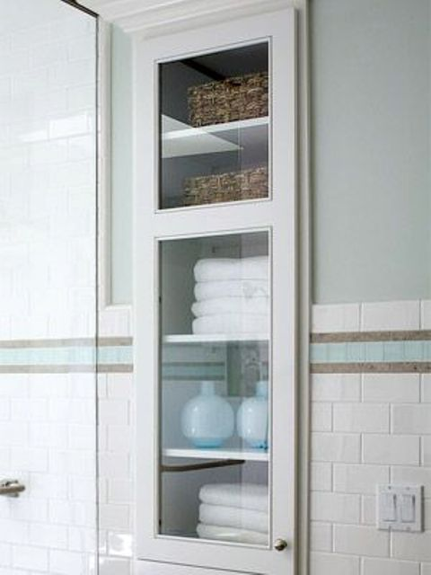 Spectacular  bathroom shelf in a narrow wall niche glass cabinet for towels