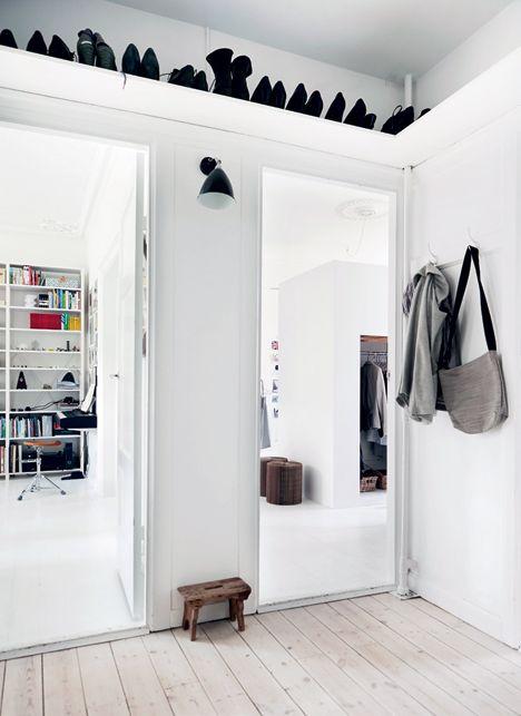 Scandinavian shoe shelf over the entryway