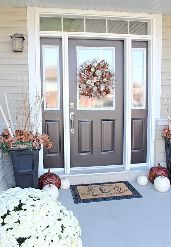 brown door and sidelights framed in white