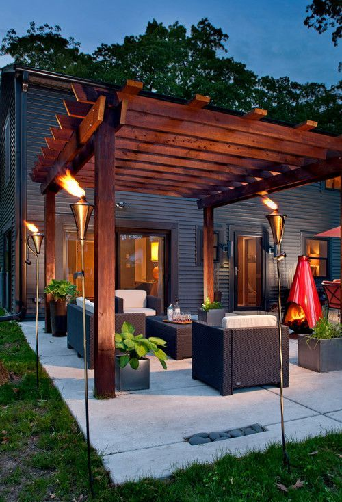 modern outdoor living room under a pergola