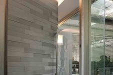 17 grey front door covered with horizontal wood panels