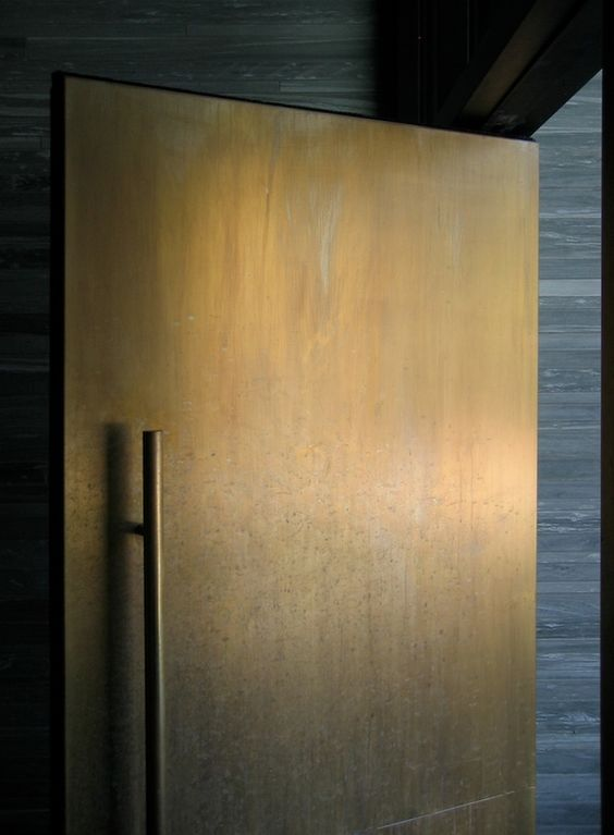 modern weathered metal front door