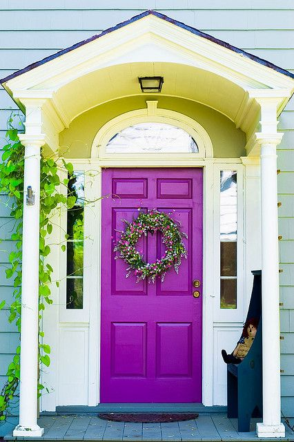 accent purple front door for a contrast