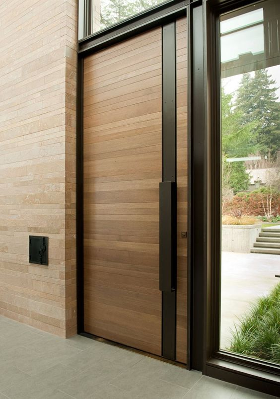 modern wood planks and steel front door with a sidelight