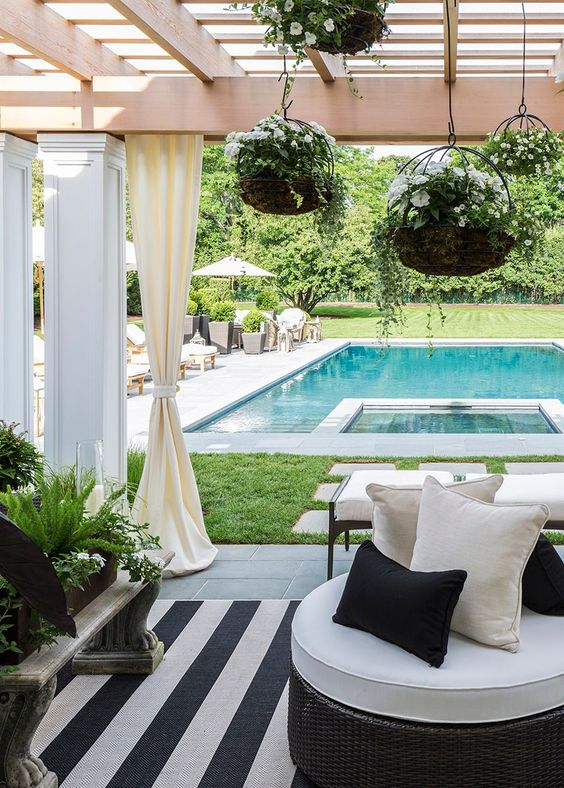 18 outdoor lounge with woven furniture and hanging planters