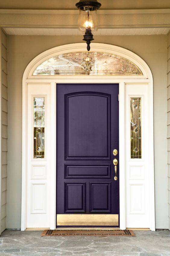 dark purple front door with gilded details