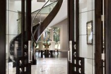 19 dark wood and glass doors with metal elements