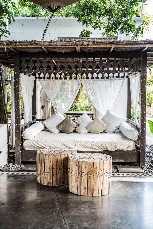 hut-inspired tiny pergola area with tribal motifs