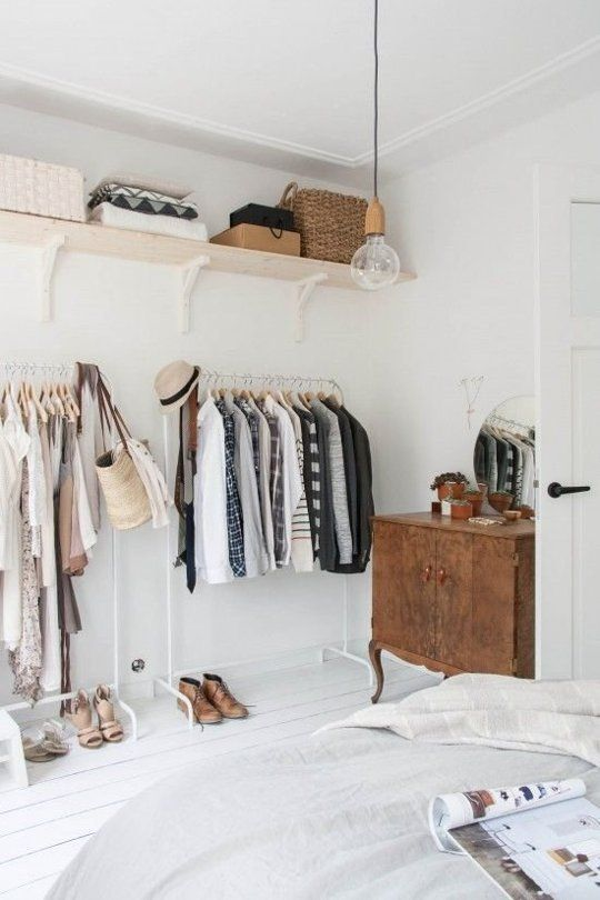 cheap IKEA's wooden shelves on white brackets combined with coat racks