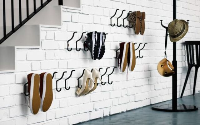 wall hooks in a mudroom for shoe storage