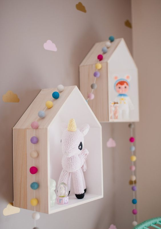 bird house shelves decorated with colorful felt garlands