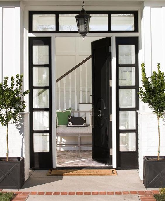 black glossy front door with sidelights