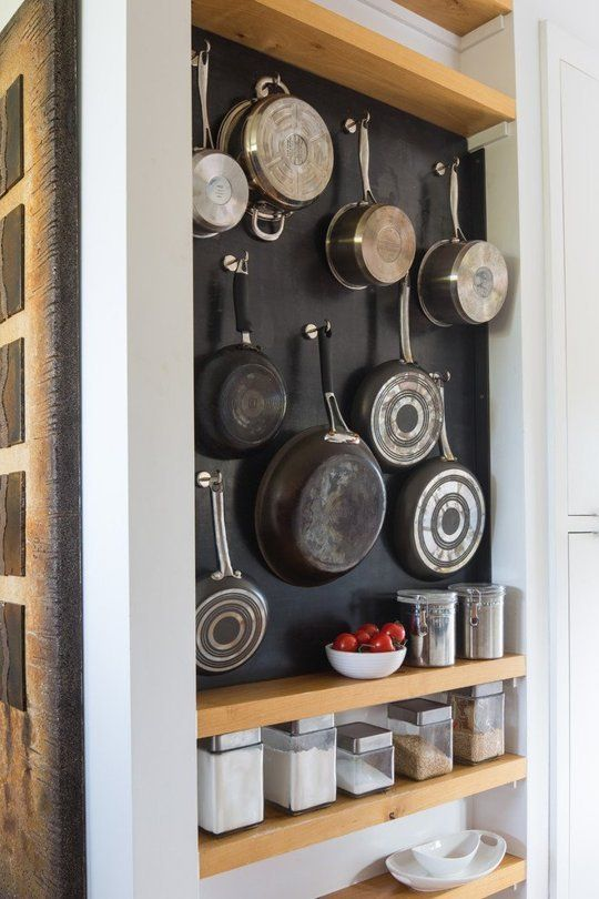 simple hooks works well to hang a bunch of pans & 27 Smart Kitchen Wall Storage Ideas - Shelterness