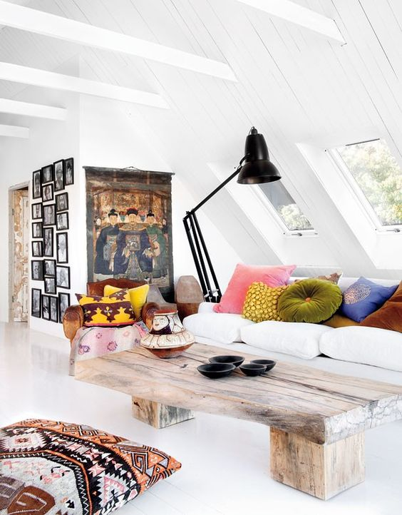 Scandinavian attic living room with a lot of windows