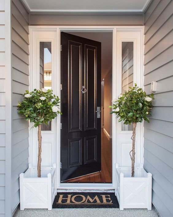 Black Glossy Front Door With Sidelights And White Entry Always Looks Stylish