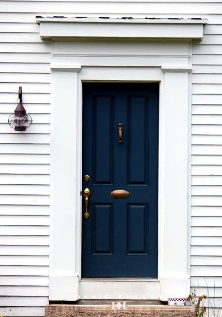navy front door with a white frame