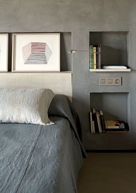 niche shelves in concrete wall used for bedside storage