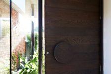 21 oversized dark wood door with a glass part