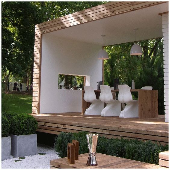 wooden pergola with a dining space