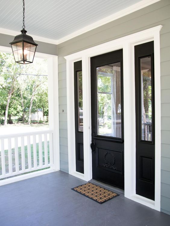 Black Door And Sidelights Mixed With White Framing