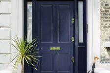 22 navy front door with gilded decor