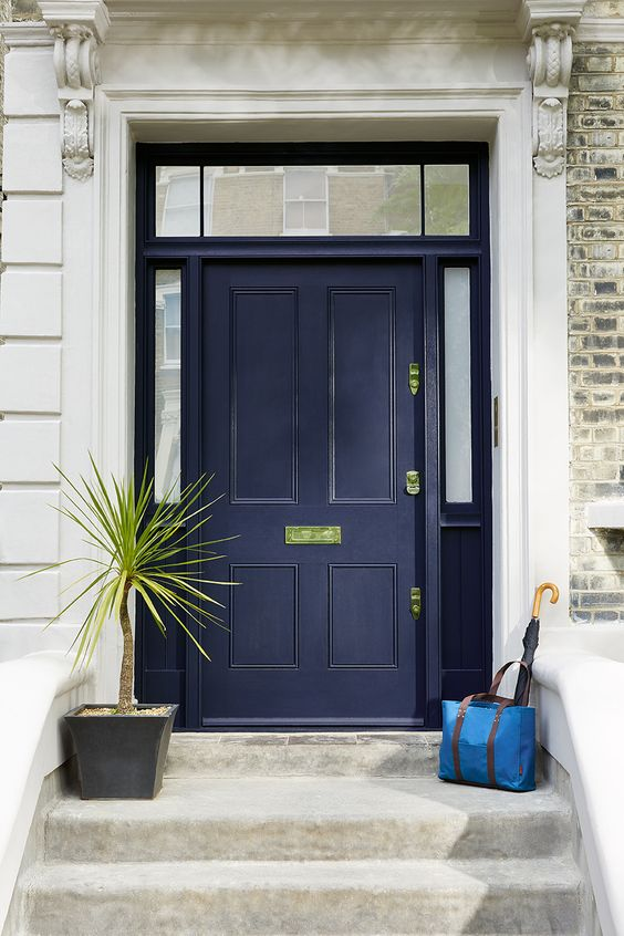 navy front door with gilded decor