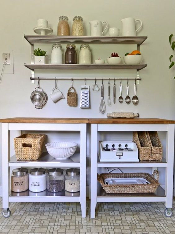 metal shelves with a rail for various tableware