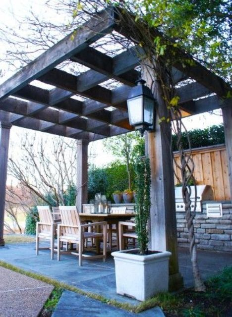 simple backyard gazebo with a grill and a dining area