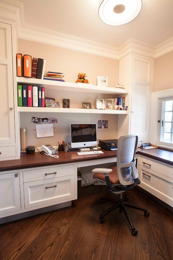 built-in shelves over the desk for easy storage and access