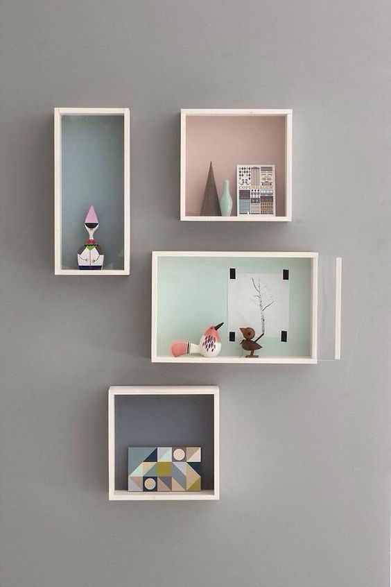 crate shelves with pastels inside
