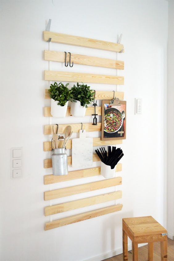 an organizer made of ikea's slatted bed base