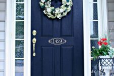 24 weathered navy front door with white decor