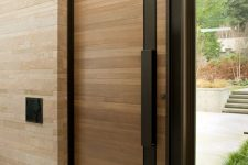 24 wood-clad modern front door with a black steel strip and handle