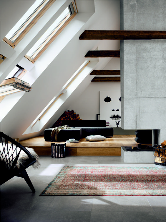 25 modern attic lviing room with a concrete fireplace