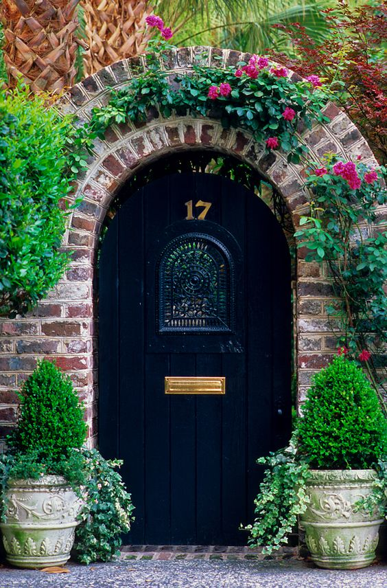 wooden navy door with an arch