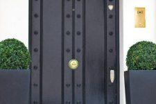 26 black metal doors with black metal pots and greenery