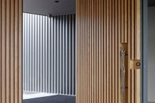 26 sculptural light-colored wood boards front door