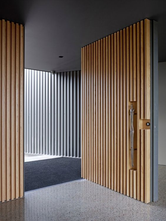 sculptural light colored wood boards front door