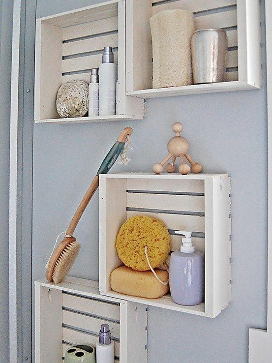 Creative bathroom shelves made of whitewashed crates.