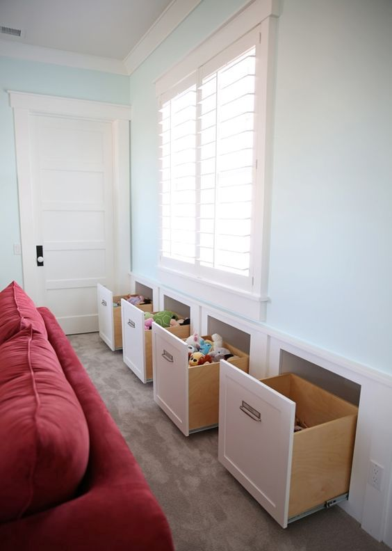 in wall toy storage to keep the room uncluttered