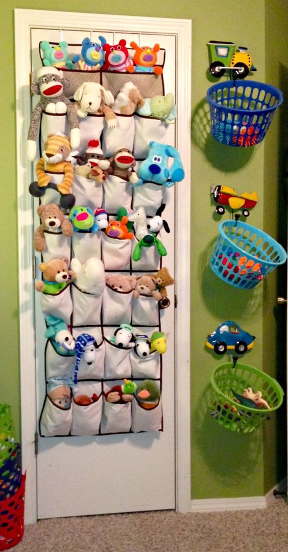 plastic cubbies attached to the wall and fabric pocket toy storage
